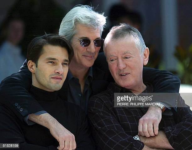 US actor Richard Gere French actor Olivier Martinez and director Adrian Lynn pose at a photocall for the presentation of their film Unfaithful in...