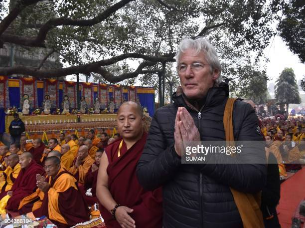 US actor Richard Gere gestures as he arrives for a series of techings by His Holiness the Dalai Lama in the Indian town of Bodhgaya on January 13...