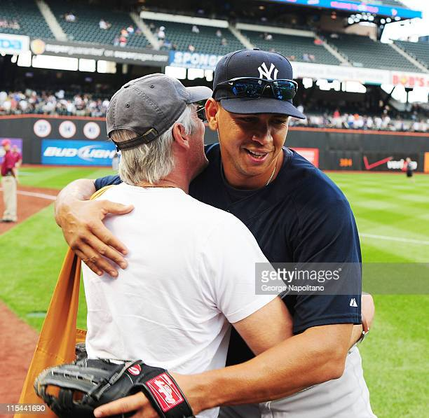 Actor Richard Gere greets Alex Rodriguez of the New York Yannkees prior to the Subway Series game between the Yankees and the Mets at Citi Field on...