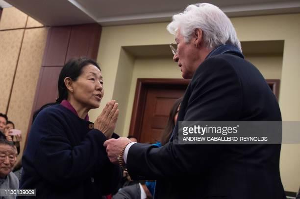 US actor Richard Gere greets Dawa Chokyi the widow of Tibetan activist Lodi Gyari during a memorial event for Gyari at the US Capitol in Washington...