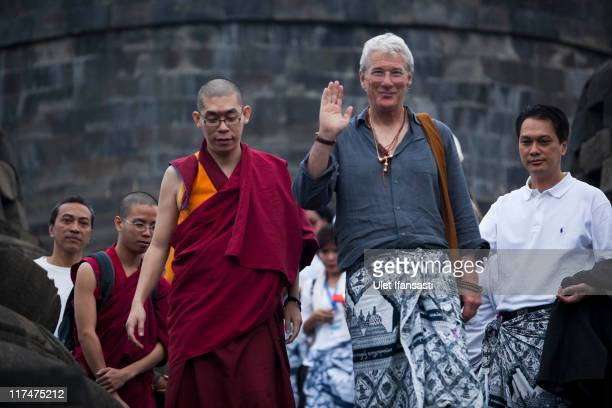 Actor Richard Gere greets journalists during his morning peace walk at Borobudur Temple on June 27 2011 in Magelang Regency Central Java Indonesia...