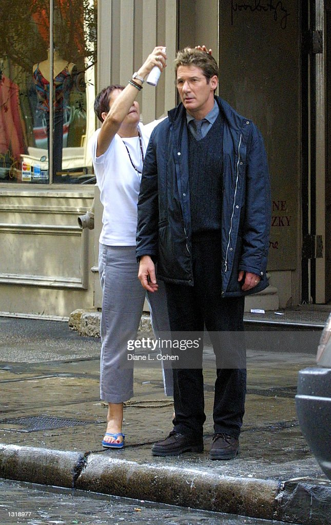 Actor Richard Gere has his hair fixed while filming the ...