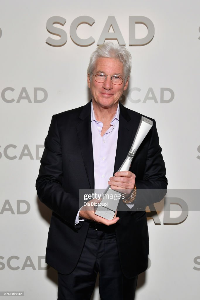 Actor Richard Gere poses backstage with the Lifetime Award at Trustees Theater during the 20th Anniversary SCAD Savannah Film Festival on November 4, 2017 in Savannah, Georgia.