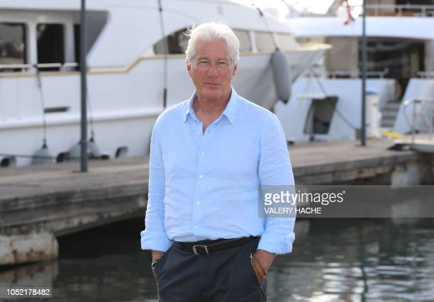"Actor Richard Gere poses during a photocall for a TV serie ""Motherfatherson"" as part of the MIPCOM, on October 15, 2018 in Cannes, southeastern..."