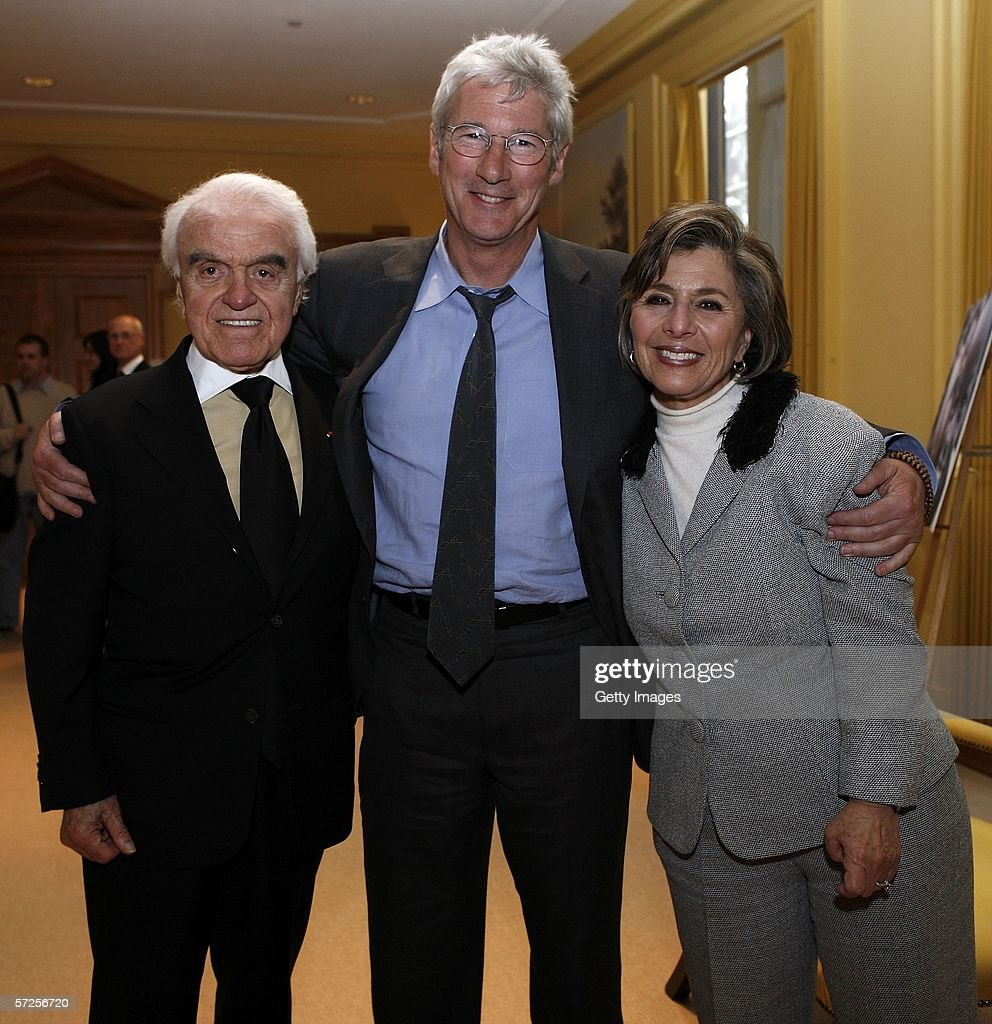 Actor Richard Gere (C) poses with former MPAA President Jack Valenti (L) and Senator Barbara Boxer (D-CA) during a reception held at the MPAA by Friends of the Global Fight April 4, 2006, in Washington, DC.