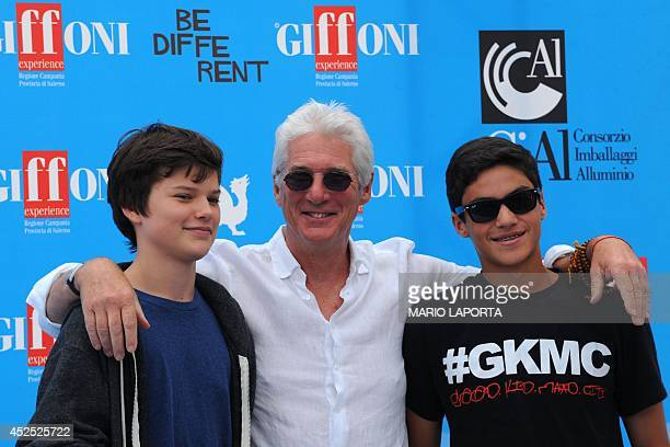Actor Richard Gere poses with his son Homer and a friend of his son during a photocall at the 44th edition of the Giffoni Film Festival for children...