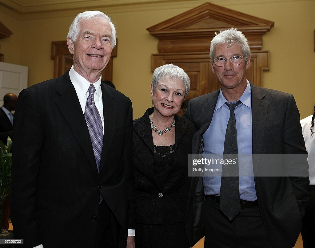Actor Richard Gere (R) poses with Senator Thad Cochran (R-MS) and Kay Webber (C), the senator's director of special services, during a reception held at the MPAA by Friends of the Global Fight April 4, 2006, in Washington, DC.