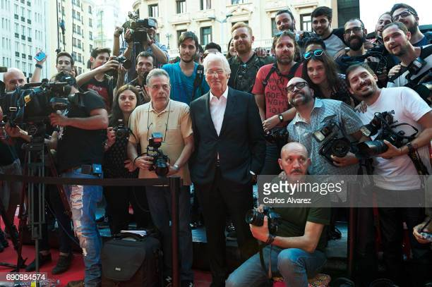 Actor Richard Gere poses with the photographers during the 'Norman The Moderate Rise and Tragic Fall of a New York Fixer' premiere at the Callao...