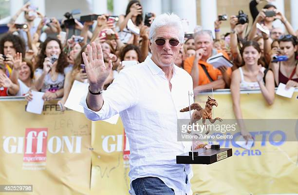 Actor Richard Gere poses with the Truffaut Award during the Giffoni Film Festival photocall on July 22 2014 in Giffoni Valle Piana Italy