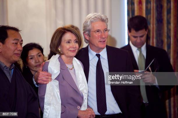 Actor Richard Gere puts his arm around House Speaker Nancy Pelosi at an event advocating for greater freedoms in Tibet on March 9 2009 in Washington...