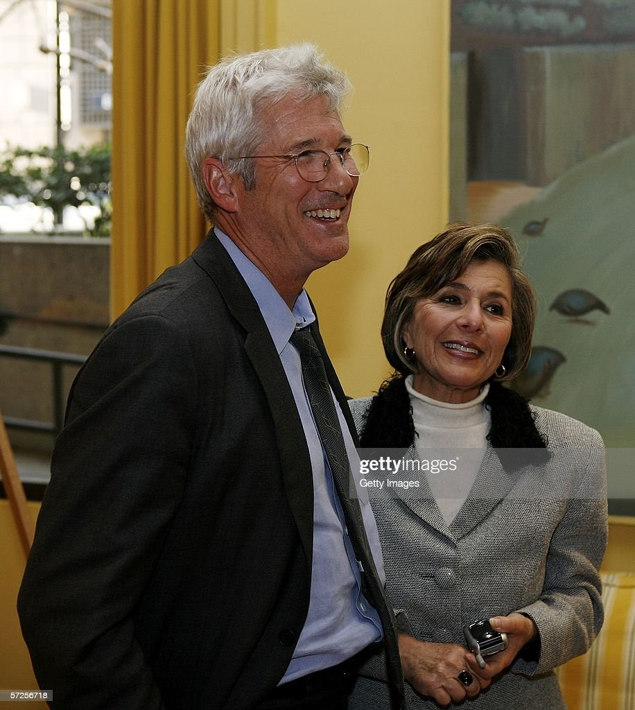 Actor Richard Gere (L) speaks with Senator Barbara Boxer (D-CA) during a reception held at the MPAA by Friends of the Global Fight April 4, 2006, in Washington, DC.