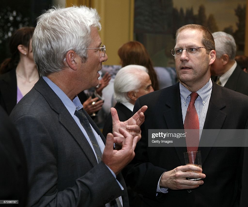 Actor Richard Gere (R) speaks with Senator John Sununu (R-NH) during a reception held at the MPAA by Friends of the Global Fight April 4, 2006, in Washington, DC.