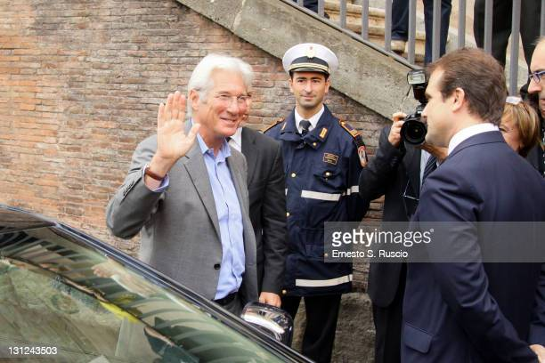 Actor Richard Gere waves to fans as he arrives to receive the Lupa Capitolina Award at the Town Hall during the 6th International Rome Film Festival...