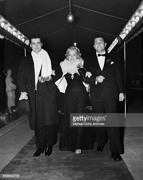Actor Richard Greene with actress Alice Faye and friend attend an event in Los Angeles California