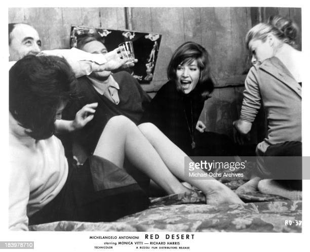 Actor Richard Harris actress Monica Vitti and actress Xenia Valderi on the set of the Rizzoli Film movie 'Red Desert' in 1964