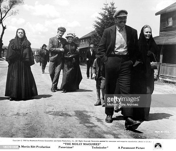Actor Richard Harris actress Samantha Eggar walk behind actor Sean Connery and actress Bethel Leslie on set of the Paramount Pictures movie 'The...