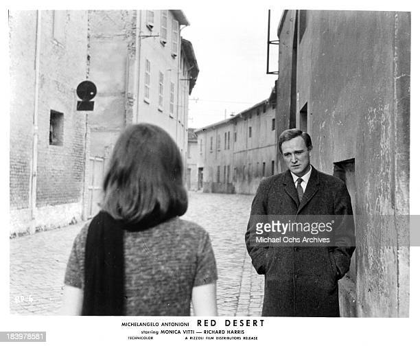 Actor Richard Harris and actress Monica Vitti on the set of the Rizzoli Film movie 'Red Desert' in 1964