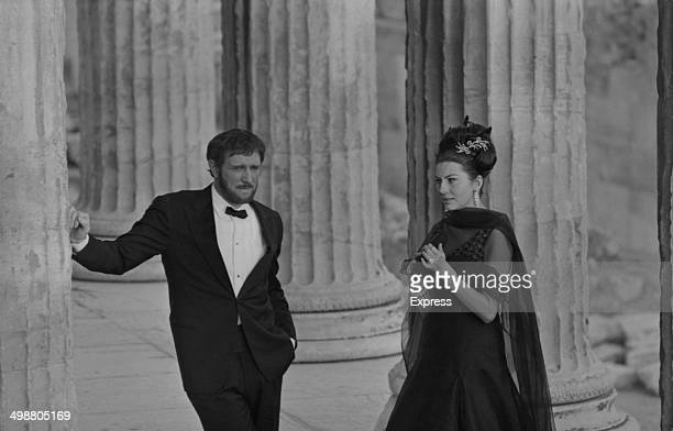Actor Richard Harris and Princess Soraya of Iran filming next to ancient ruins 1964
