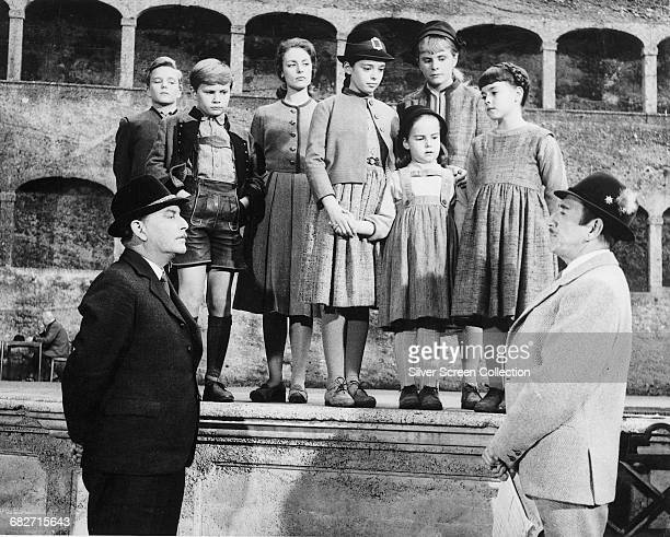 Actor Richard Haydn as Max Detweiler entering the von Trapp children into the Salzburg Festival in a scene from the musical film 'The Sound of Music'...