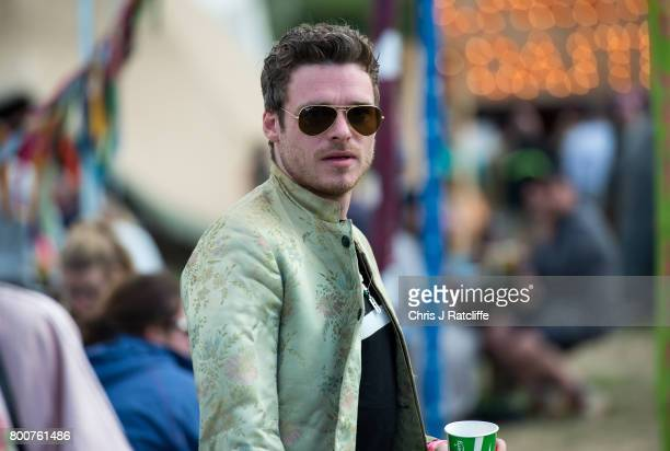 Actor Richard Madden who plays Robb Stark in Game of Thrones is seen at Glastonbury Festival Site on June 25 2017 in Glastonbury England As...