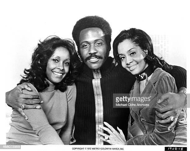 """Actor Richard Roundtree with actresses Kathy Imrie and Rosalind Miles on set of the movie """"Shaft's Big Score!"""", circa 1972."""