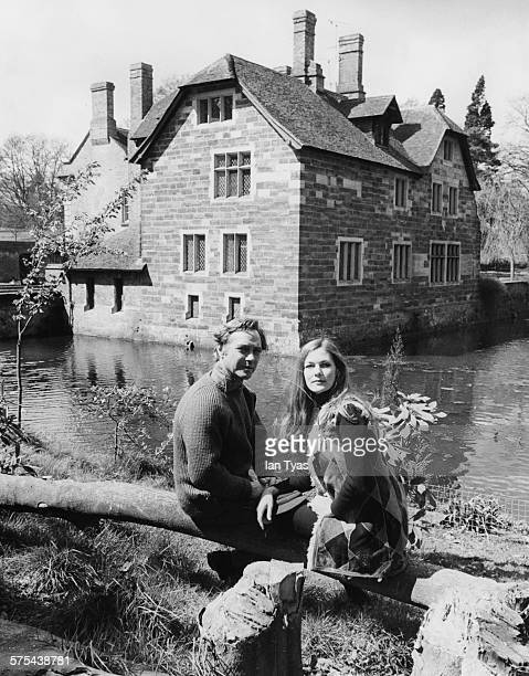 Actor Richard Todd and his wife Virginia Mailer pictured sitting next to the river in the grounds of their 15th century manor house in Kent May 1972