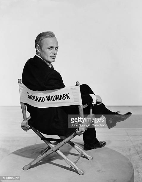 Actor Richard Widmark Sitting in Chair Bearing his Name