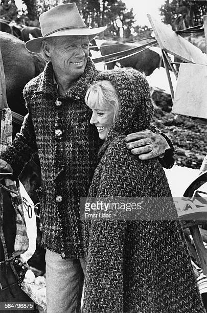 Actor Richard Widmark with actress Lola Albright on the set of the film 'The Way West' directed by Andrew V McLaglen USA 1967 Widmark plays Lije...