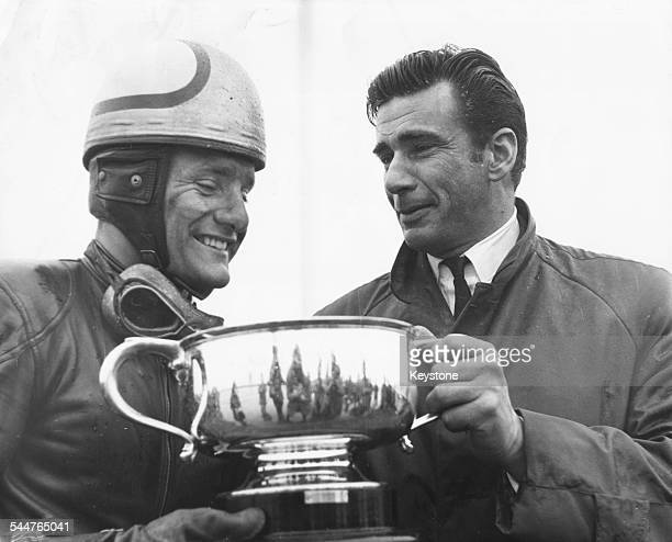 Actor Richard Wyler presenting the Commonwealth Trophy to racing driver Mike Hailwood, at the Easter Monday Motor Cycle meeting at Thruxton, England,...
