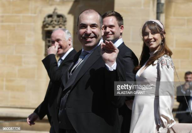 US actor Rick Hoffman waves as he arrives for the wedding ceremony of Britain's Prince Harry Duke of Sussex and US actress Meghan Markle at St...
