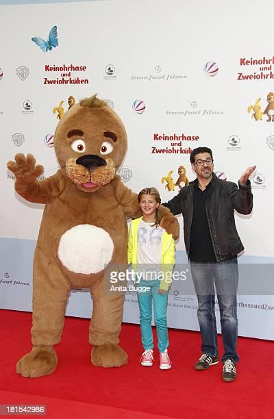 Actor Rick Kavanian and Emma Schweiger attend the premiere of the film 'Keinohrhase und Zweiohrkueken' at CineStar on September 22 2013 in Berlin...