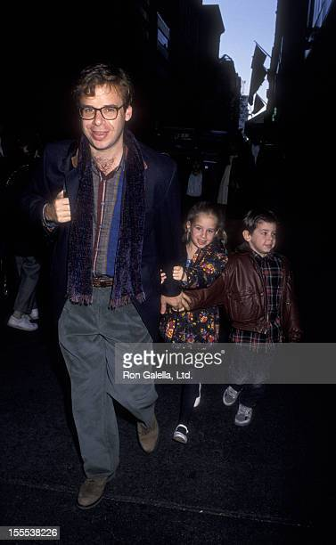 Actor Rick Moranis and children attend the premiere of The Nutcracker on November 21 1993 at the Ziegfeld Theater in New York City