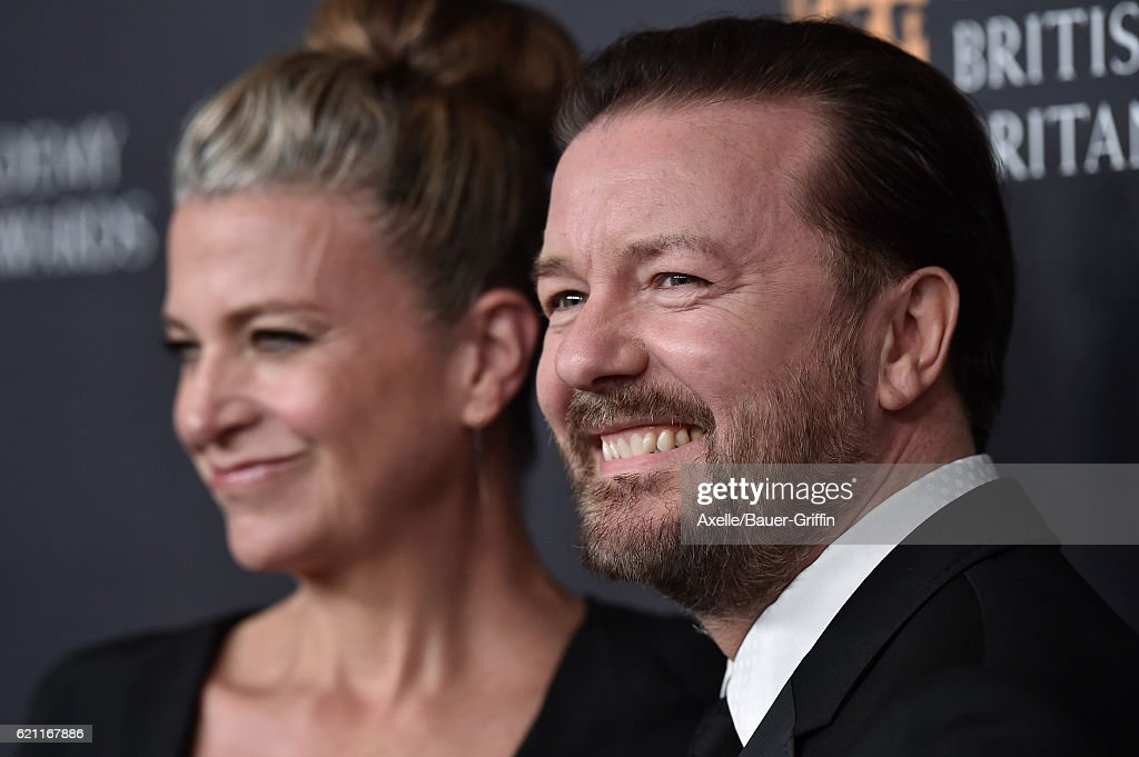 Actor Ricky Gervais and Jane Fallon arrive at the 2016 AMD British Academy Britannia Awards presented by Jaguar Land Rover and American Airlines at The Beverly Hilton Hotel on October 28, 2016 in Beverly Hills, California.