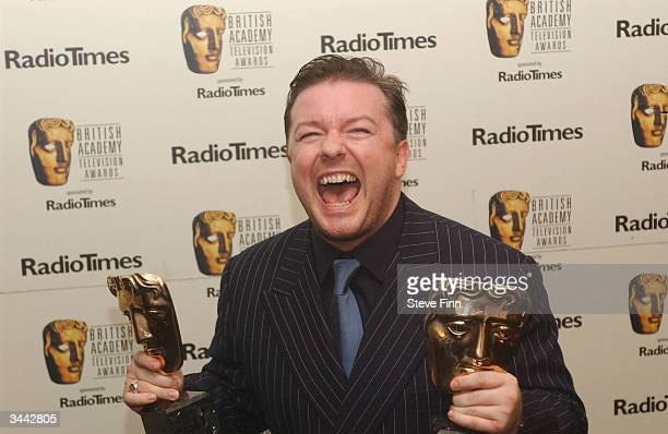 Actor Ricky Gervais poses in the pressroom with awards for Best Situation Comedy and Comedy performance following the The British Academy Television...