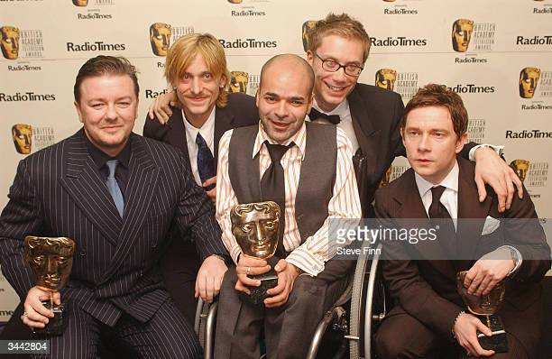 """Actor Ricky Gervais poses with the fellow members of The Office with awards for Best Situation Comedy and Comedy performance following the """"The..."""