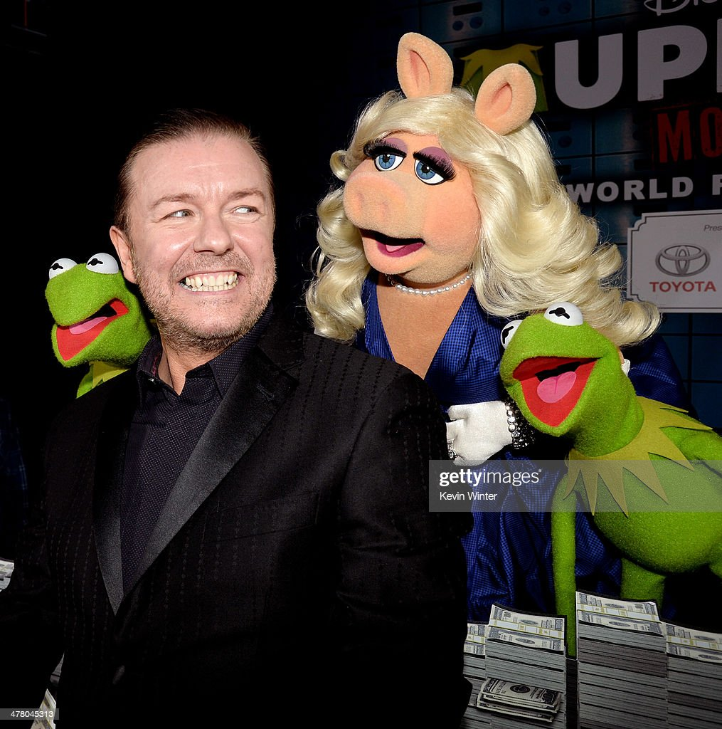 Actor Ricky Gervais, with Constantine, (L), Miss Piggy and Kermit the Frog pose at the premiere of Disney's 'Muppets Most Wanted' at the El Capitan Theatre on March 11, 2014 in Los Angeles, California.