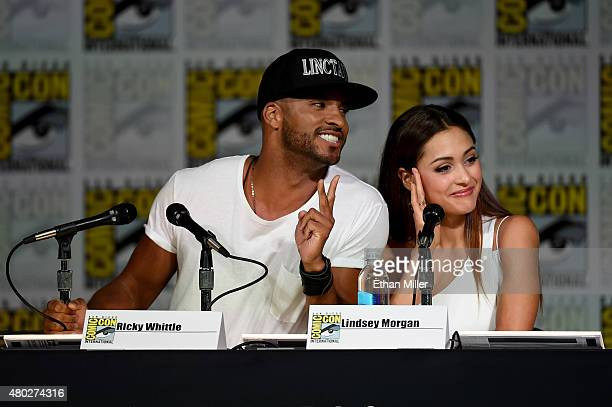 Actor Ricky Whittle and actress Lindsey Morgan attend a special video presentation and panel for 'The 100' during ComicCon International 2015 at the...