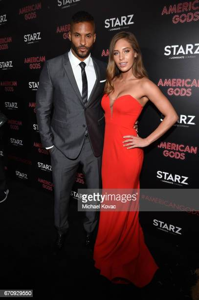 Actor Ricky Whittle and Kirstina Colonna attend the 'American Gods' premiere at ArcLight Hollywood on April 20 2017 in Los Angeles California