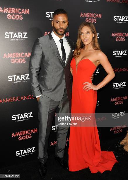 Actor Ricky Whittle and Kirstina Colonna attend the premiere of 'American Gods' at ArcLight Cinemas Cinerama Dome on April 20 2017 in Hollywood...