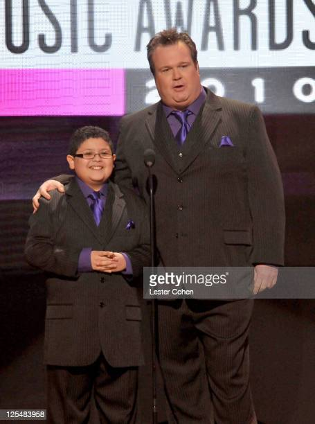 Actor Rico Rodriguez and actor Eric Stonestreet speak onstage during the 2010 American Music Awards held at Nokia Theatre L.A. Live on November 21,...