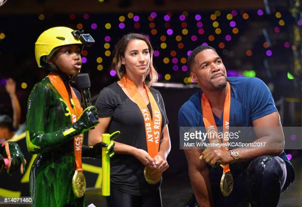 Actor Riele Downs Olympic gymnast Aly Raisman and Michael Strahan participate in a competition during Nickelodeon Kids' Choice Sports Awards 2017 at...