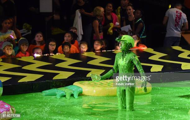 Actor Riele Downs participates in a competition onstage during Nickelodeon Kids' Choice Sports Awards 2017 at Pauley Pavilion on July 13 2017 in Los...