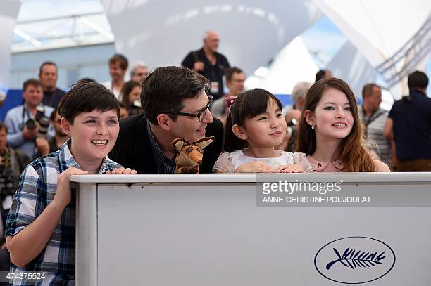 US actor Riley Osborne US director Mark Osborne Japanese actress Rio Suzuki and US actress Mackenzie Foy pose during a photocall for the film The...