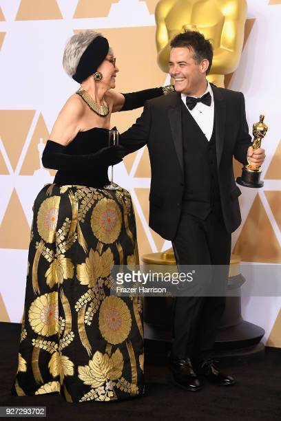 Actor Rita Moreno and director Sebastian Lelio winner of the Best Foreign Language Film award for 'A Fantastic Woman' pose in the press room during...