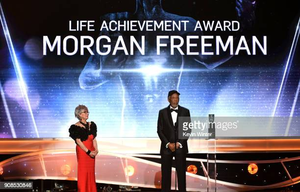 Actor Rita Moreno listens to honoree Morgan Freeman accept the Life Achievement Award onstage during the 24th Annual Screen Actors Guild Awards at...
