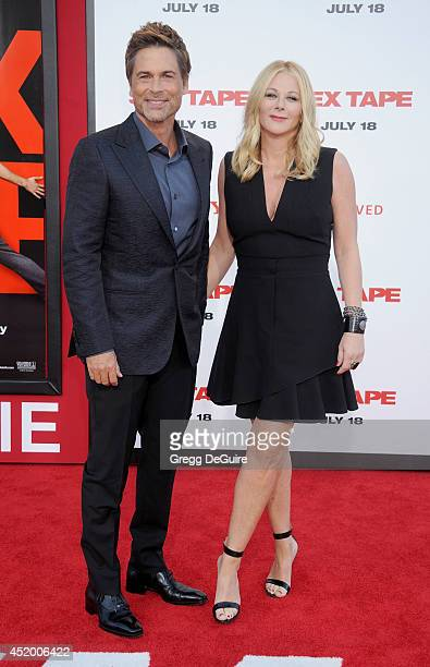 Actor Rob Lowe and wife Sheryl Berkoff arrive at the Los Angeles premiere of Sex Tape at Regency Village Theatre on July 10 2014 in Westwood...