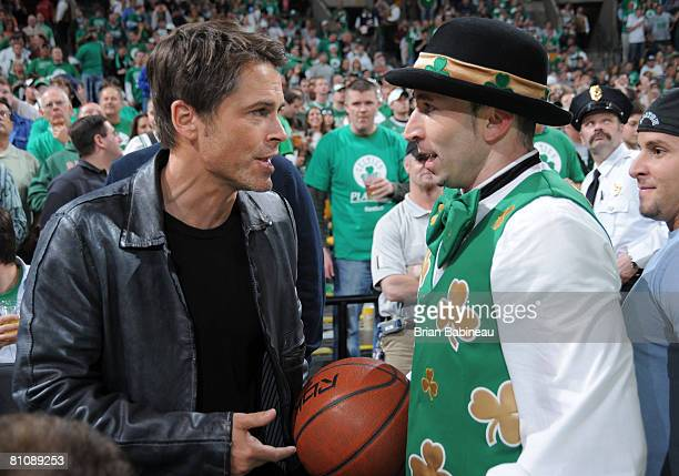 Actor Rob Lowe meets Lucky the Leprechaun mascot for the Boston Celtics at Game Five of the Eastern Conference Semifinals during the 2008 NBA...