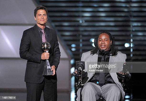 Actor Rob Lowe presents the Jimmy V Award for Perseverence to Eric LeGrand onstage during the 2012 ESPY Awards at Nokia Theatre LA Live on July 11...