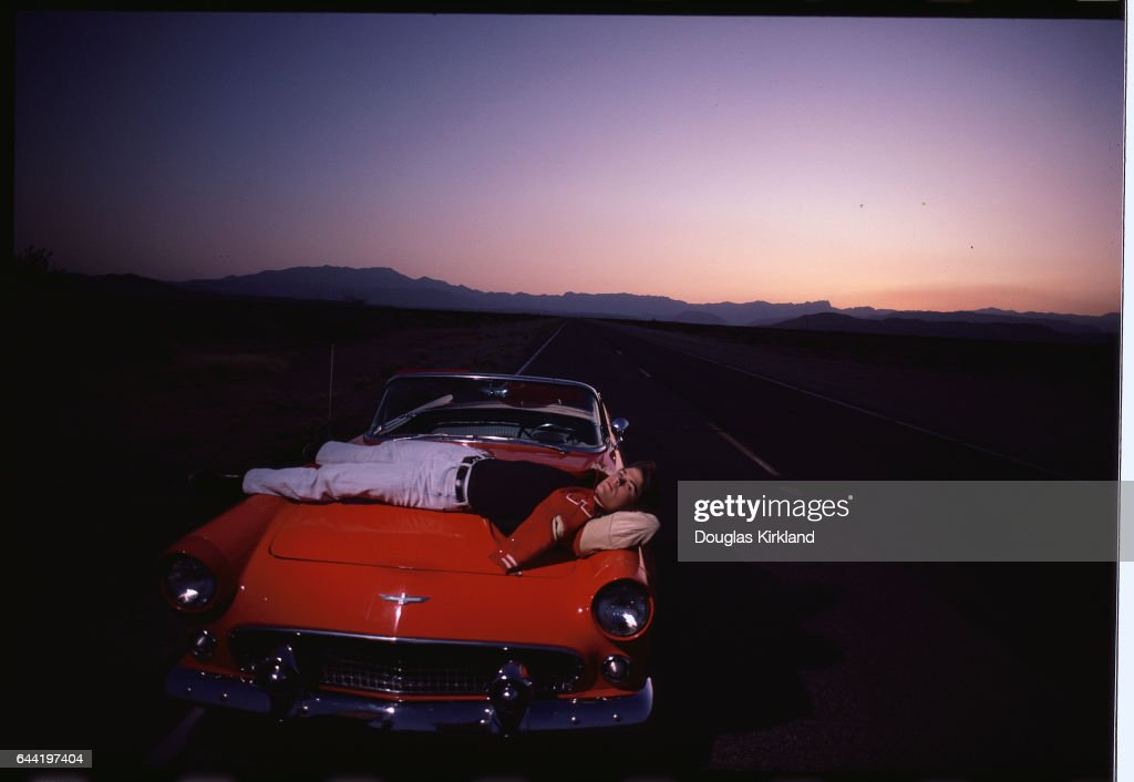 Actor Rob Lowe Relaxing on Corvette Hood
