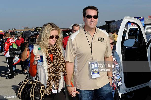 Actor Rob Riggle and his wife Tiffany Riggle attend the NASCAR Sprint Cup Series Hollywood Casino 400 at Kansas Speedway on October 21 2012 in Kansas...